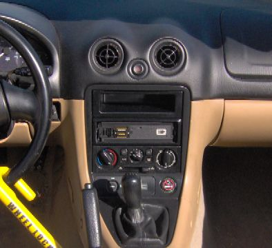 Kenwood KDC-x891 without faceplate installed in a 1999 Mazda Miata (day)